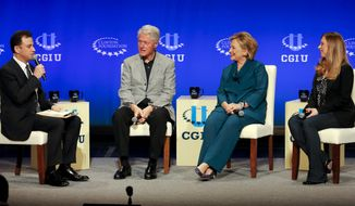 Talk show host Jimmy Kimmel, from left, former President Bill Clinton former Secretary of State Hillary Rodham Clinton and Vice Chair of the Clinton Foundation, Chelsea Clinton speak during a student conference for the Clinton Global Initiative University, Saturday, March 22, 2014, at Arizona State University in Tempe, Ariz. More than 1,000 college students are gathered at Arizona State University this weekend as part of the Clinton Global Initiative University's efforts to advance solutions to pressing world challenges. (AP Photo/Matt York)