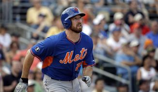 New York Mets' Ike Davis hits a two-run home run to score teammate Matt den Dekker in the seventh inning of an exhibition spring training baseball game against the Miami Marlins, Saturday, March 22, 2014, in Jupiter, Fla. (AP Photo/David Goldman)