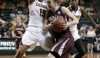 California's Brittany Boyd (15) defends against a drive to the basket by Fordham's Erin Rooney in the second half of a first-round game in the NCAA women's college basketball tournament, Saturday, March 22, 2014, in Waco, Texas. (AP Photo/Tony Gutierrez)