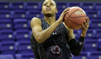 South Carolina guard Tiffany Mitchell puts up a shot during practice at the NCAA women's college basketball tournament, Saturday, March 22, 2014, in Seattle. South Carolina is scheduled to play Cal State Northridge in a first-round game on Sunday. (AP Photo/Ted S. Warren)