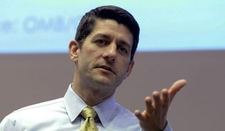 **FILE** Rep. Paul Ryan, Wisconsin Republican, answers constituents' questions during a listening session at the Snap-on Headquarters in Kenosha, Wis., on March 20, 2014. (Associated Press/Kenosha News, Kevin Poirier)