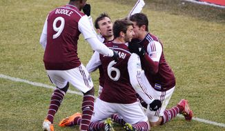 Colorado Rapids' Edson Buddle (9), Jose Mari (6), Vincente Sanchez (facing camera) and Dillon Posers (8) celebrate Sanchez's goal in the second half of an MLS soccer game against the Portland Timbers in Commerce City, Colo., Saturday, March 22. 2014. Colorado won 2-0. (AP Photo/The Denver Post, Hyoung Chang) MAGAZINES OUT; TV OUT; INTERNET OUT; NO SALES; NEW YORK POST OUT; NEW YORK DAILY NEWS OUT