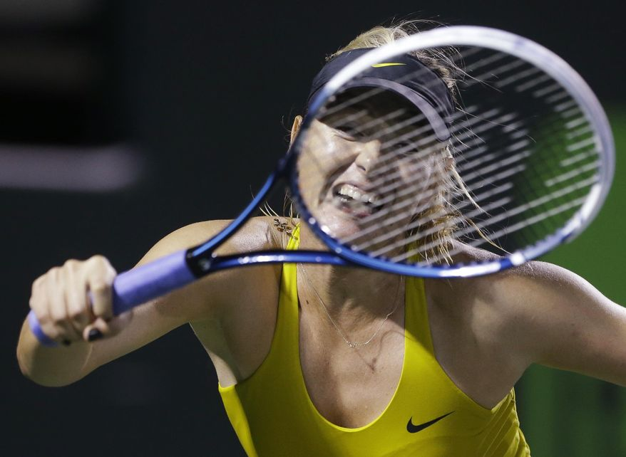 Maria Sharapova, of Russia, returns a shot from Lucie Safarova, of the The Czech Republic, during the Sony Open tennis tournament, Saturday, March 22, 2014, in Key Biscayne, Fla. (AP Photo/Wilfredo Lee)