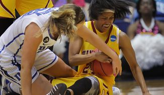 Duke's Tricia Liston fights for a loose ball with Winthrop's Samiya Wright  during the second half of their first-round game in the NCAA basketball tournament in Durham, N.C., Saturday, March 22, 2014. Duke won 87-45.  (AP Photo/Ted Richardson)