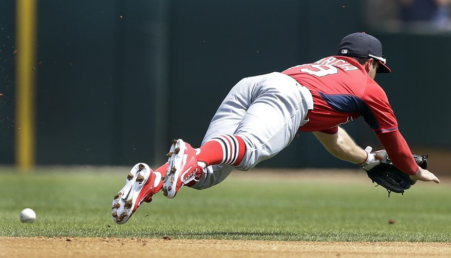 St. Louis Cardinals second baseman Greg Garcia reacts but allows the single by Houston Astros' Dexter Fowler to get by during the fourth inning of a spring exhibition baseball game in Kissimmee, Fla., Saturday, March 22, 2014. (AP Photo/Carlos Osorio)
