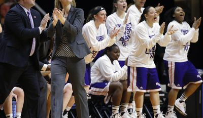 Northwestern State co-head coaches Scott Stoehr, left, and Brooke Stoehr applaud a score against Tennessee in the first half of an NCAA women's college basketball first-round tournament game, Saturday, March 22, 2014, in Knoxville, Tenn. (AP Photo/Mark Humphrey)