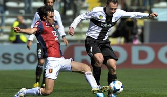 Parma's Antonio Antonio Cassano, right, vies for the ball with Genoa's Paolo De Ceglie, during their Serie A soccer match at Parma's Tardini stadium, Italy, Sunday, March 23, 2014. (AP Photo/Marco Vasini)