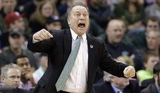 Michigan State head coach Tom Izzo yells toward the court against Harvard in the first half during the third round of the NCAA men's college basketball tournament in Spokane, Wash., Saturday, March 22, 2014. (AP Photo/Elaine Thompson)