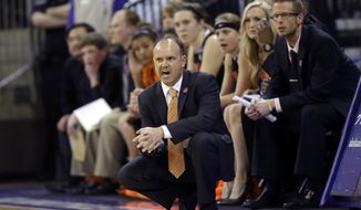 Oregon State head coach Scott Rueck kneels by his bench in the first half of a first-round game against Middle Tennessee State in the NCAA women's college basketball tournament, Sunday, March 23, 2014, in Seattle. (AP Photo/Ted S. Warren)