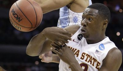 Iowa State's Daniel Edozie, right, and North Carolina's James Michael McAdoo, left, battle for a rebound during the first half of a third-round game in the NCAA college basketball tournament Sunday, March 23, 2014, in San Antonio. (AP Photo/David J. Phillip)