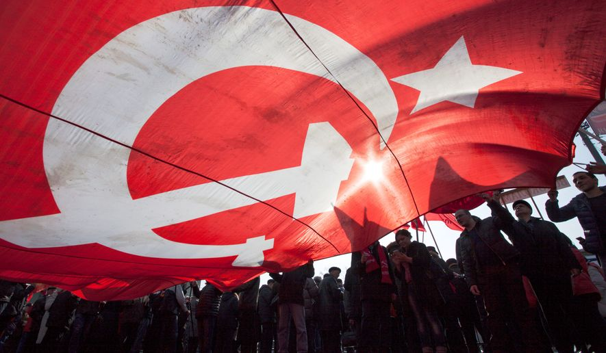 Russian Communist party supporters carry a huge former Soviet Union Red flag during a rally in support of Crimea joining Russia near the Red Square in Moscow, Russia, on Saturday, March 22, 2014. (Associated Press) ** FILE **