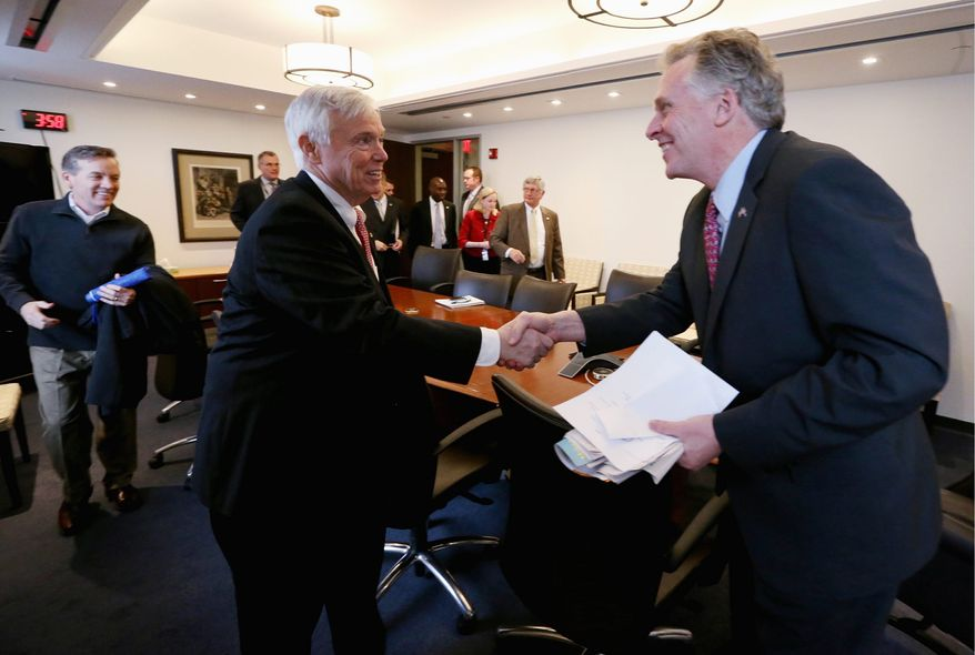 Fiscal Face-off: Virginia Gov. Terry McAuliffe (right) says it's common sense to accept federal money for Medicaid, but House Speaker William J. Howell says Virginia can't rely on the promise of a government that is carrying $17 trillion in debt. (Associated Press)