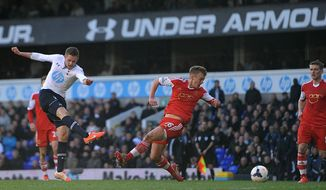 Tottenham Hotspur's Gylfi Sigurdsson, left,  scores his team's third goal of the game during the English Premier League soccer match against Southampton at White Hart Lane, London Sunday March 23, 2014. Tottenham won the match 3-2. (AP {Photo/Adam Davy/PA) UNITED KINGDOM OUT