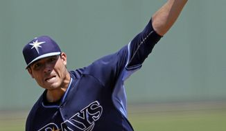 Tampa Bay Rays starting pitcher Matt Moore throws in the first inning of an exhibition baseball game against the Boston Red Sox in Fort Myers, Fla., Sunday, March 23, 2014. (AP Photo/Gerald Herbert)