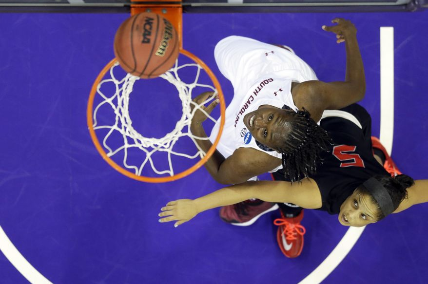 South Carolina forward Aleighsa Welch, left, and Cal State Northridge guard Ashlee Guay, right, watch as Welch's shot goes in during the first half of a first-round game in the NCAA women's college basketball tournament, Sunday, March 23, 2014, in Seattle. (AP Photo/Ted S. Warren)