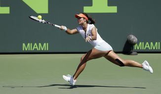 Li Na, of China, returns to Madison Keys at the Sony Open tennis tournament in Key Biscayne, Fla., Sunday, March 23, 2014. (AP Photo/Alan Diaz)