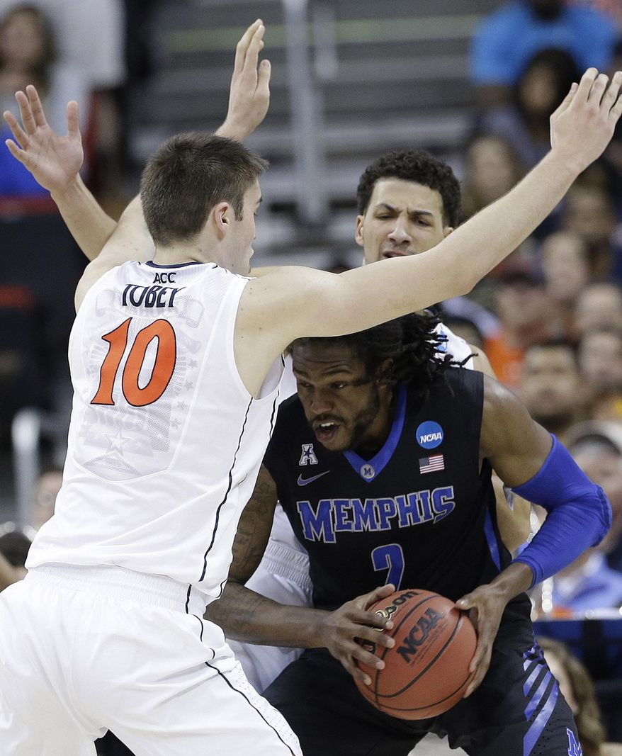 Memphis forward Shaq Goodwin (2) drives to drive through Virginia forward/center Mike Tobey (10) during the first half of an NCAA college basketball third-round tournament game, Sunday, March 23, 2014, in Raleigh. (AP Photo/Gerry Broome)