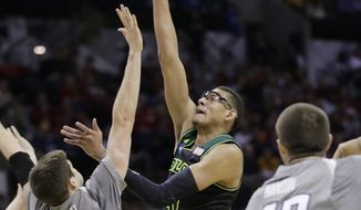 Baylor's Isaiah Austin, center, shoots over Creighton's Doug McDermott (3) during the first half of a third-round game in the NCAA college basketball tournament Sunday, March 23, 2014, in San Antonio. (AP Photo/Eric Gay)