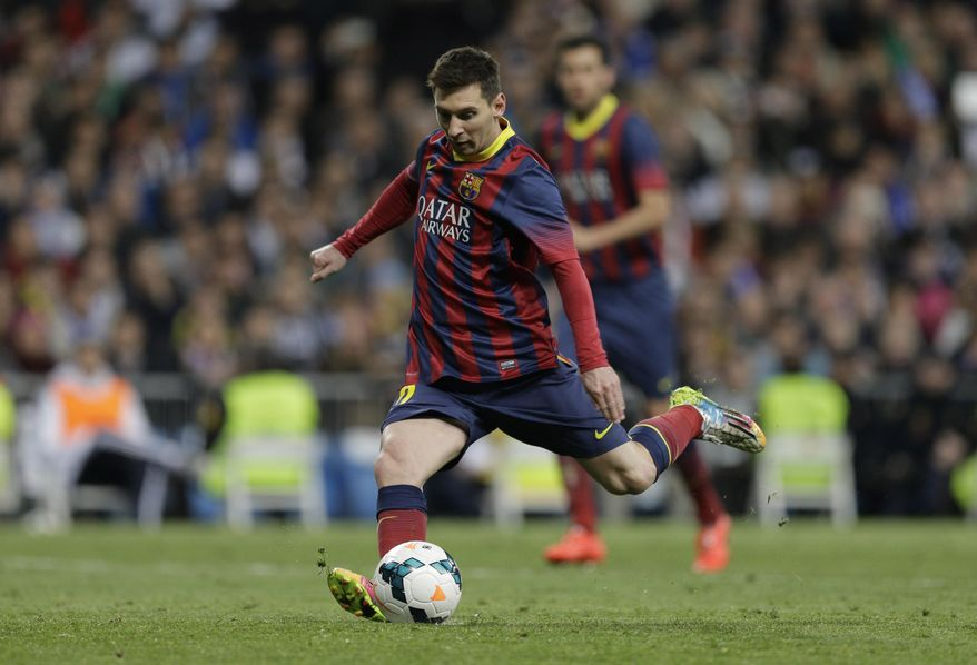 FC Barcelona's Lionel Messi from Argentina scores a penalty  during a Spanish La Liga soccer match against Real Madrid,  at the Santiago Bernabeu stadium in Madrid, Sunday March 23, 2014. (AP Photo/Paul White)