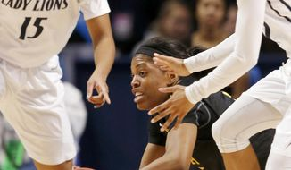 Wichita State's Michelle Price, center, dives for the ball in front of Penn State's Kaliyah Mitchell (15) during the first half in a first-round game in the NCAA college basketball tournament on Sunday, March 23, 2014, in State College, Pa. (AP Photo/Keith Srakocic)
