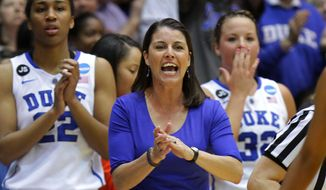 Duke coach Joanne P. McCallie urges her team during the first half against Winthrop in a first-round game in the NCAA college basketball tournament in Durham, N.C., Saturday, March 22, 2014. Duke won 87-45.  (AP Photo/Ted Richardson)