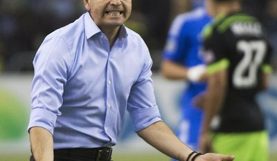 Montreal Impact's coach Frank Klopas reacts on the sideline during the second half of an MLS soccer game against the Seattle Sounders in Montreal, Sunday, March 23, 2014. (AP Photo/The Canadian Press, Graham Hughes)