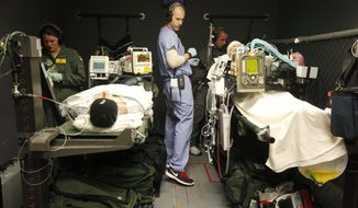 Wednesday, March 12, 2014: NEWS. Members of the Air Force, who are also doctors and nurses, train inside of the C-STARS (Center for Sustainment of Trauma and Readiness Skills) simulation center as a part of the joint program between University of Cincinnati Medical Center and the Air Force offering training for military medical personnel in the areas of trauma and critical care. (AP Photo/The Cincinnati Enquirer, Amanda Rossmann)