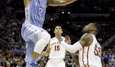 North Carolina's Leslie McDonald (2) goes up for a shot as Iowa State's DeAndre Kane (50) defends during the first half of a third-round game in the NCAA college basketball tournament Sunday, March 23, 2014, in San Antonio. (AP Photo/David J. Phillip)