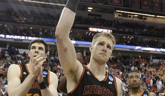 Mercer forward Jakob Gollon (20) waves to the crowd after the second half of an NCAA college basketball third-round tournament game against Tennessee, Sunday, March 23, 2014, in Raleigh. Tennessee Won 83-63. (AP Photo/Chuck Burton)