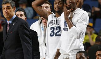 Villanova head coach Jay Wright watches during the second half of a third-round game against Connecticut in the NCAA men's college basketball tournament in Buffalo, N.Y., Saturday, March 22, 2014. Connecticut won the game 77-65. (AP Photo/Bill Wippert)