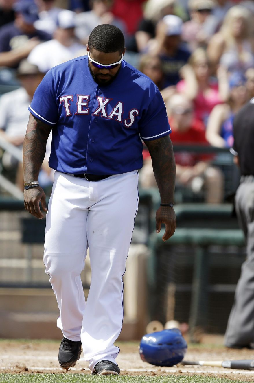 Texas Rangers' Prince Fielder walks away from home plate after striking out during the first inning of a spring exhibition baseball game against the San Diego Padres, Sunday, March 23, 2014, in Surprise, Ariz. (AP Photo/Darron Cummings)