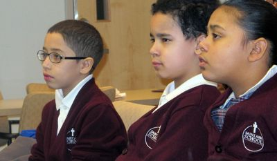 In this Feb. 25, 2014 photo, third-graders, from left, Jan Carlos Medina, Matthew Velez and Natalie Mieses take in a class that teaches them about stroke on Feb. 25, 2014, at Montefiore Hospital in the Bronx, N.Y. The hospital educates children to recognize stroke and get victims to a hospital quickly. (AP Photo/Jim Fitzgerald)