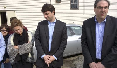 Rhode Island Democratic Rep. Michael Marcello, right, speaks to reporters beside Rep. Christopher Blazejewski, center, and supporters outside a firemen's hall, Sunday, March 23, 2014 in Johnston, R.I. Marcello is seeking the speaker of the House position after Speaker Gordon Fox relinquished it Saturday following twin raids Friday at his Statehouse office and home as part of a criminal investigation. Officials will not say whom or what they are investigating. Blazejewski is Marcello's choice for majority leader. A formal House vote is expected Tuesday. (AP Photo/Erika Niedowski)