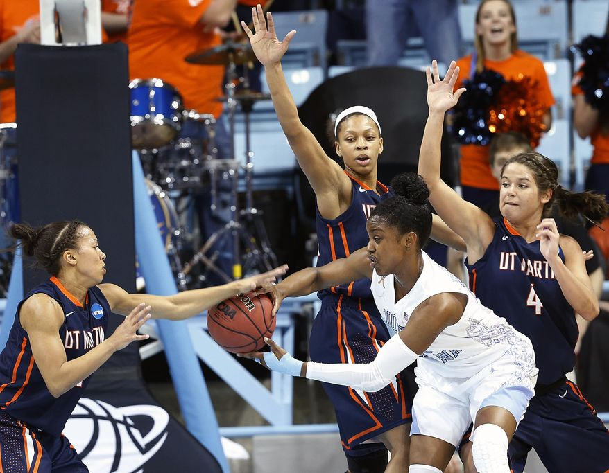 North Carolina's Diamond DeSheilds looks to make a pass under pressure from UT Martin players Heather Butler, left, Ashia Jones, and Elizabeth Masengil (4) during the first half of a first-round game in the NCAA women's college basketball tournament, Sunday, March 23, 2014, in Chapel Hill, N.C. (AP Photo/Ellen Ozier)