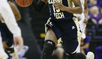Georgia Tech guard Tyaunna Marshall (15) dribbles upcourt against LSU in the second half of an NCAA college basketball first-round tournament game on Sunday, March 23, 2014, in Baton Rouge, La. LSU won 98-78. (AP Photo/Rogelio V. Solis)