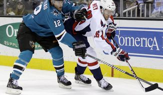 Washington Capitals' Patrick Wey, right, battles for the puck with San Jose Sharks' Patrick Marleau (12) during the first period of an NHL hockey game on Saturday, March 22, 2014, in San Jose, Calif. (AP Photo/Marcio Jose Sanchez)