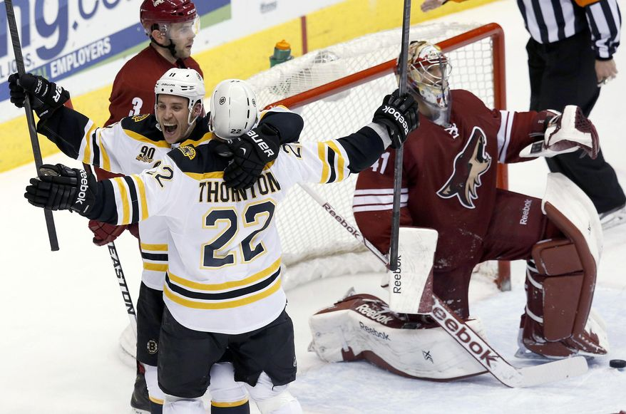 Boston Bruins' Shawn Thornton (22) celebrates his goal against Phoenix Coyotes' Mike Smith, right, with teammate Gregory Campbell (11) as Coyotes' Keith Yandle (3) skates past during the third period of an NHL hockey game Saturday, March 22, 2014, in Glendale, Ariz. The Bruins defeated the Coyotes 4-2. (AP Photo/Ross D. Franklin)