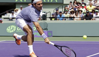 Roger Federer, of Switzerland, returns to Thiemo de Bakker, of the Netherlands, at the Sony Open tennis tournament in Key Biscayne, Fla., Sunday, March 23, 2014. (AP Photo/Alan Diaz)