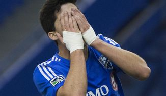 Montreal Impact's Eric Miller reacts after missing a shot on goal against the Seattle Sounders duringthe  second half of an MLS soccer game in Montreal, Sunday, March 23, 2014. (AP Photo/The Canadian Press, Graham Hughes)