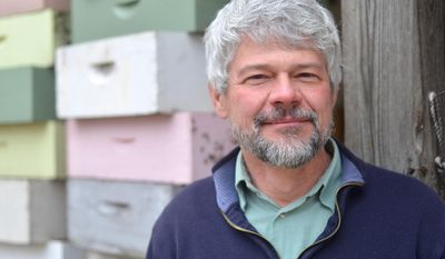 UGA researcher Keith Delaplane is photographed at the UGA honeybee lab in Athens, Ga.,  on March 6, 2014.  Delaplane for years has studied bees and the reasons the possible reasons behind their population decline.  (AP Photo/The Banner-Herald, Richard Hamm) MAGS OUT; MANDATORY CREDIT