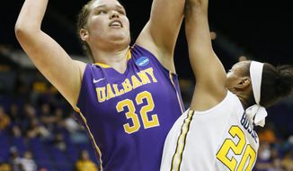 Albany center Megan Craig (32) attempts a shot at the basket while West Virginia center Asya Bussie (20) defends in the first half of an NCAA college basketball first-round tournament game on Sunday, March 23, 2014, in Baton Rouge, La. (AP Photo/Rogelio V. Solis)