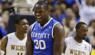Kentucky forward Julius Randle (30) celebrates against Wichita State  during the second half of a third-round game of the NCAA college basketball tournament Sunday, March 23, 2014, in St. Louis. (AP Photo/Jeff Roberson)
