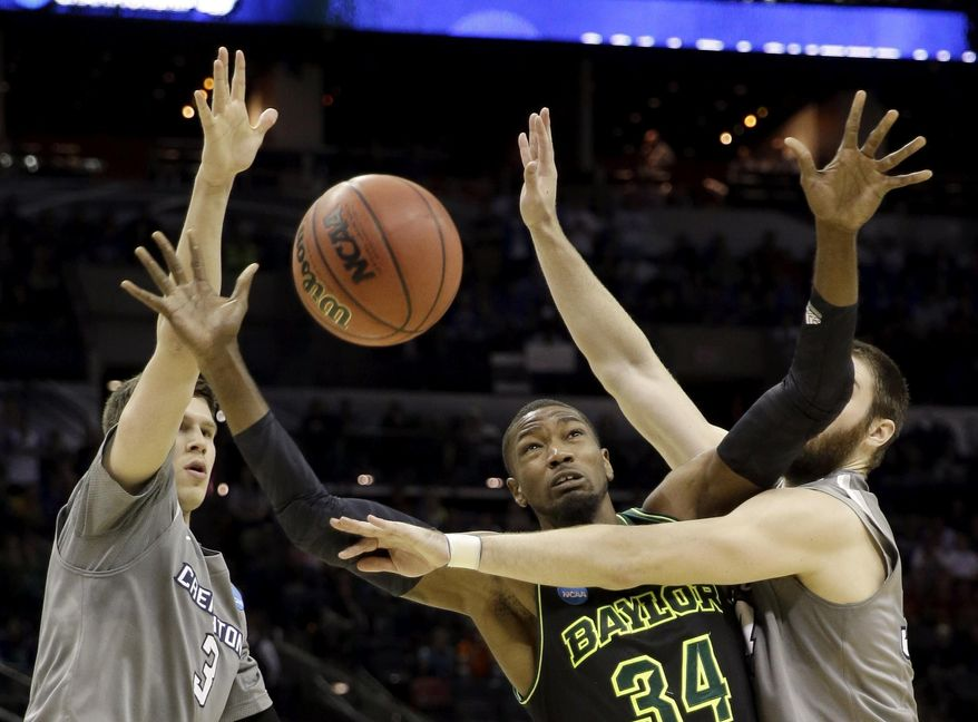 Baylor's Cory Jefferson (34) loses the ball as Creighton's Ethan Wragge, right, and Doug McDermott (3) defend during the second half of a third-round game in the NCAA college basketball tournament Sunday, March 23, 2014, in San Antonio. Baylor won 85-55. (AP Photo/David J. Phillip)