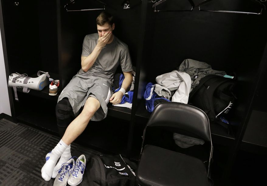 Creighton's Grant Gibbs sits in the locker room after losing to Baylor in a third-round game in the NCAA college basketball tournament Sunday, March 23, 2014, in San Antonio. Baylor won 85-55. (AP Photo/David J. Phillip)