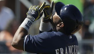 Milwaukee Brewers' Juan Francisco reacts after hitting a solo home run during the fourth inning of a spring exhibition baseball game against the Seattle Mariners on Wednesday, March 19, 2014, in Peoria, Ariz. (AP Photo/Darron Cummings)