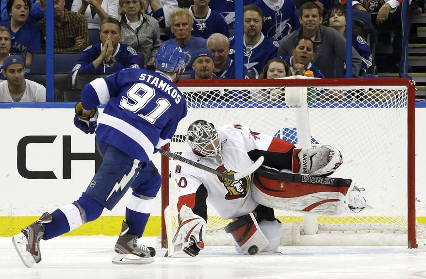 Ottawa Senators goalie Robin Lehner (40) stops Tampa Bay Lightning center Steven Stamkos (91) during a shootout in an NHL hockey game Monday, March 24, 2014, in Tampa, Fla. The Senators won the game 4-3. (AP Photo/Chris O'Meara)