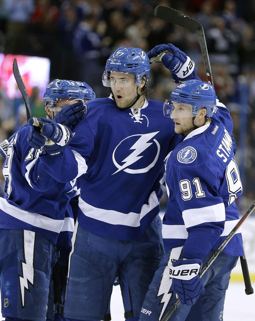 Tampa Bay Lightning defenseman Victor Hedman (77), of Sweden, celebrates his goal against the Ottawa Senators with teammate center Steven Stamkos (91) during the second period of an NHL hockey game Monday, March 24, 2014, in Tampa, Fla. (AP Photo/Chris O'Meara)