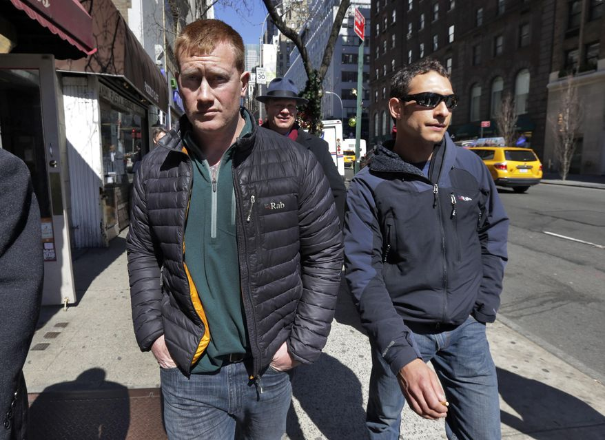 """James Brady, left, and Andrew Rossig, right, two parachutists who jumped from One World Trader Center in September 2013, are accompanied by attorney Timothy Parlatore to surrender to police, in New York,  Monday, March 24, 2014.  Monday's arrests come eight days after a 16-year-old was arrested on charges of climbing up to the top of the nation's biggest skyscraper. Police had no immediate information on Monday's arrests. They had said they were looking for two parachutists seen floating near the building Sept. 30. The defense attorneys say  three accused jumpers and an alleged accomplice on the ground are expecting to face felony burglary charges. The attorneys say the defendants are experienced BASE jumpers, the acronym stands for """"building, span, antenna, earth."""" The lawyers say the men took care to keep from endangering anyone. (AP Photo/Richard Drew)"""