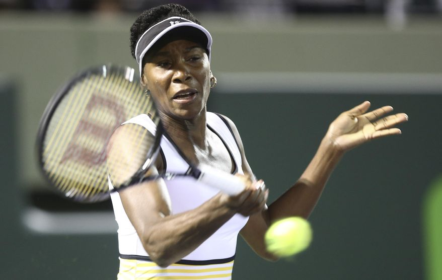 Venus Williams, of the United States, retuns the ball to Dominika Cibulkova, of Slovakia,during the Sony Open Tennis in Key Biscayne, Fla., Monday, March 24, 2014. (AP Photo/J Pat Carter)