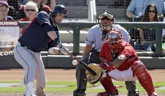 Cleveland Indians' Jason Kipnis hits a three-run home run off Cincinnati Reds relief pitcher J.J. Hoover as Reds' catcher Brayan Pena and home plate umpire D.J. Reyburn watch  in the sixth inning of a spring exhibition baseball game Monday, March 24, 2014, in Goodyear, Ariz. (AP Photo/Mark Duncan)